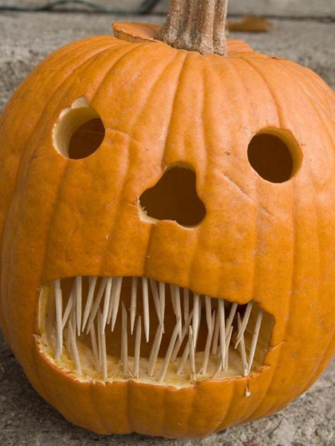 iStock-4639032_toothpick-teeth-pumpkin-carving_s3x4_lg Top 60 Creative Pumpkin Carving Ideas for a Happy Halloween