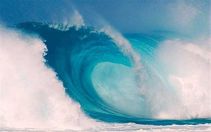surf-wave_2134340b 70 Stunning & Thrilling Photos for the Biggest Waves Ever Surfed