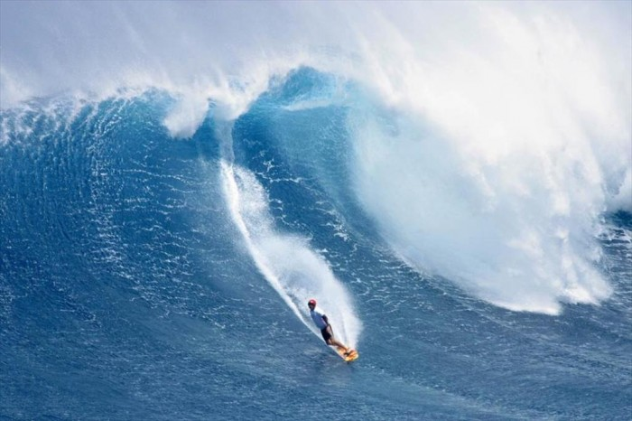 surfer-catching-wave 70 Stunning & Thrilling Photos for the Biggest Waves Ever Surfed