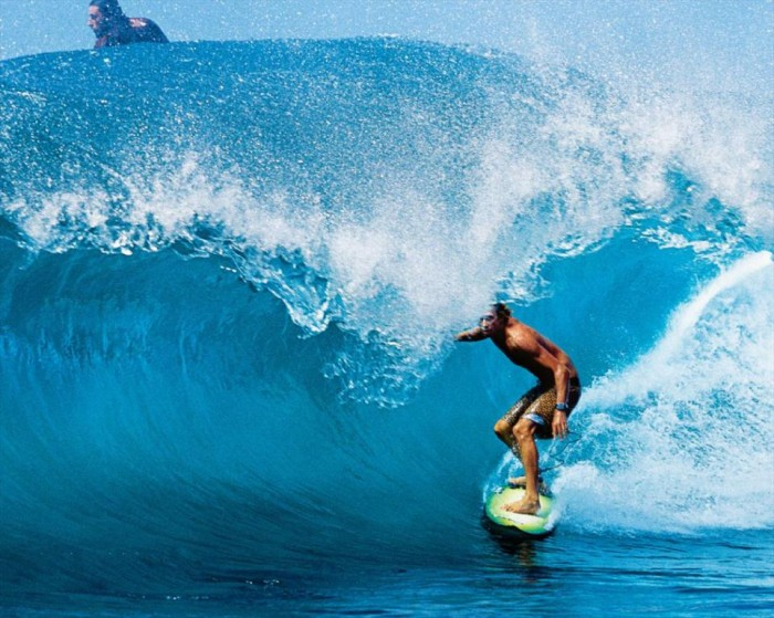surfer-under-and-on-the-wave 70 Stunning & Thrilling Photos for the Biggest Waves Ever Surfed
