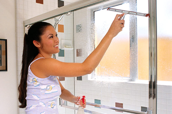 woman-asian-wash-shower-door-glass-bathroom-590jn032910 6 Tips For Cleaning Glass Without Leaving Any Streaks