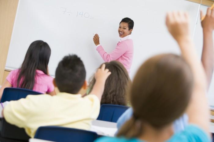 Teacher-holding-elementary-school-maths-class 10 Math Tips for Teens to Get Better Grades
