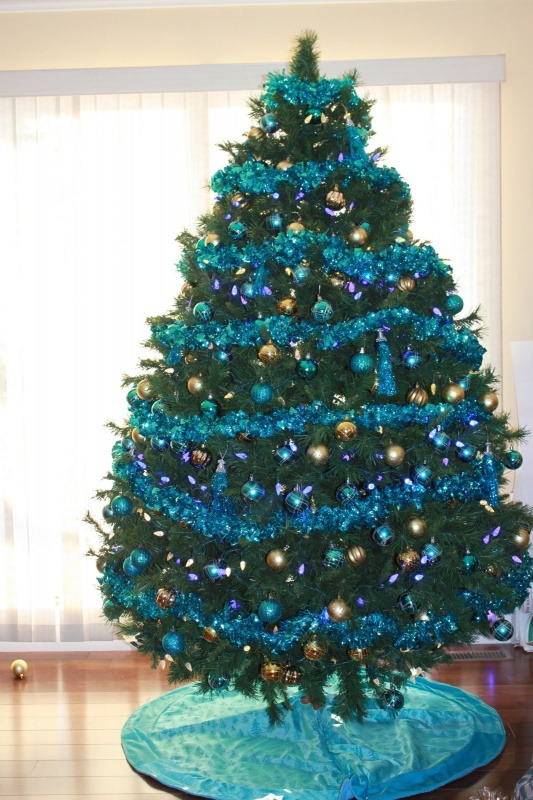 cool-design-ideas-amazing-christmas-tree-adorned-with-fancy-colorful-blue-and-gold-christmas-shatter-proof-ornaments-and-lovely-glittering-blue-twist-holy-colorful-christmas-tree-decorations 79 Amazing Christmas Tree Decorations