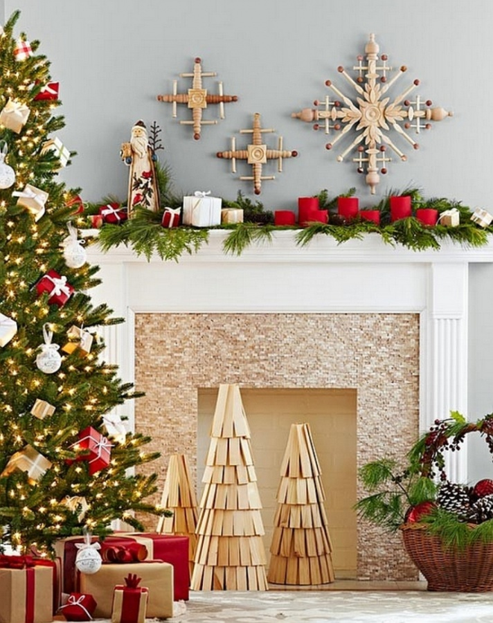 diy-wooden-christmas-tree-replicas-and-handmade-snowflakes-adorn-the-fireplace 65+ Dazzling Christmas Decorating Ideas for Your Home in 2019