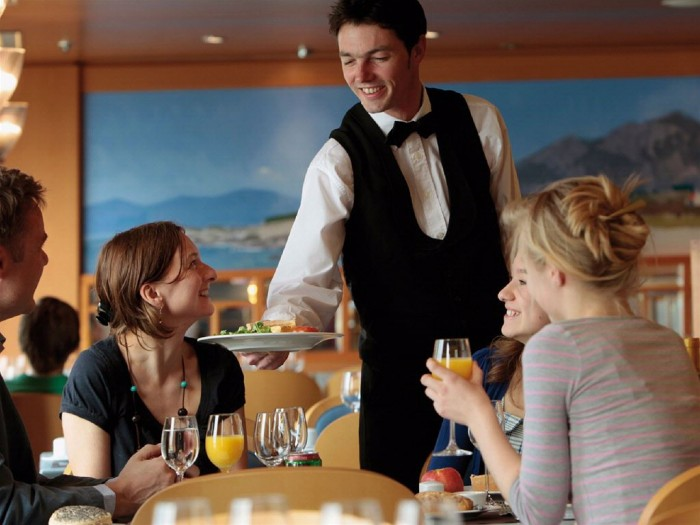 family-eating-in-the-restaurant_-waiter-serving-food-to-the-table_base1 15 Tips to Help You Save Money on Entertainment