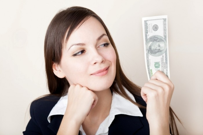 girl-looking-at-money Family Budgeting for Setting Your Financial Priorities & Saving money