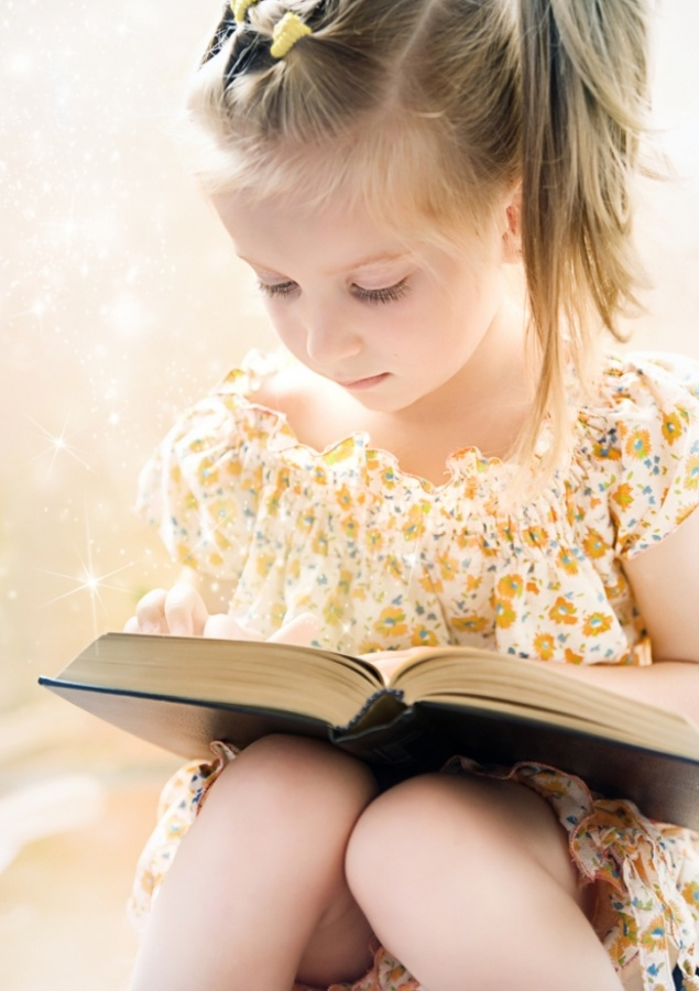 girl-reading-book-eyes-down Do You Know How to Train Your Child to Use the Five Senses?