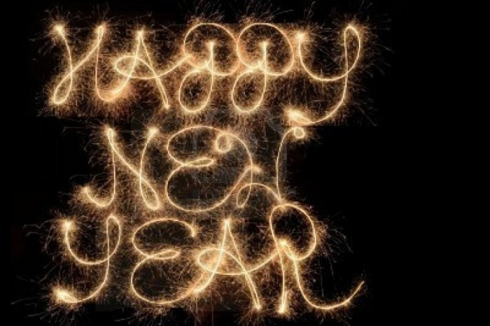 happy-new-year-written-with-sparklers-in-the-sky Awesome & Breathtaking Ideas for New Year's Holiday Decorations