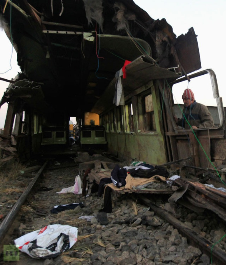 inspects-wreckage-train-crash What Are the Most Serious & Catastrophic Train Accidents in 2013?