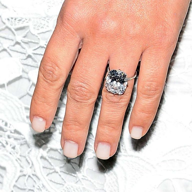 kim-kardashian-engagement-ring-nails-cuticles-w724 35+ Fascinating & Stunning Celebrities Engagement Rings for 2019