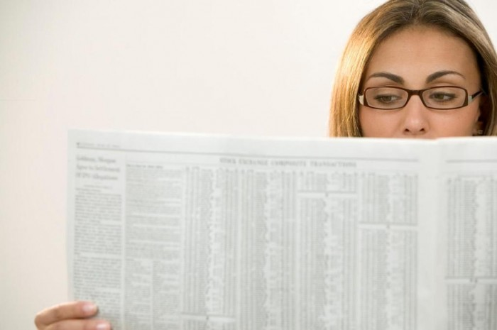 woman-paper 15 Tips to Help You Save Money on Entertainment