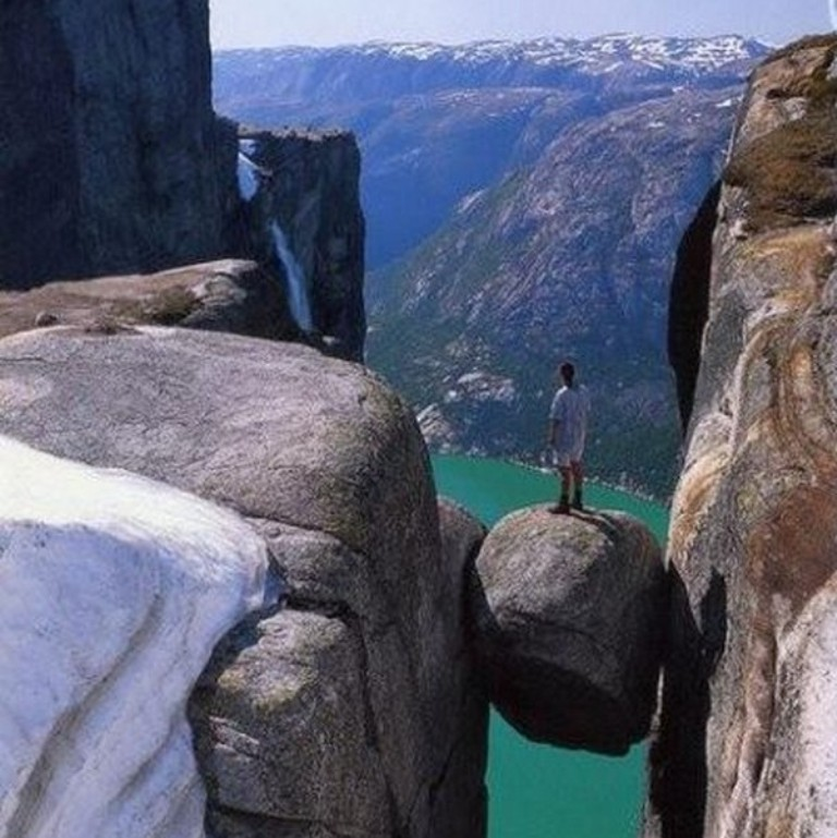 Kjeragbolten-boulder-located-in-the-Kjerag-mountain-in-Rogaland-Norway.-3 Top 10 Best Quality of Life Countries