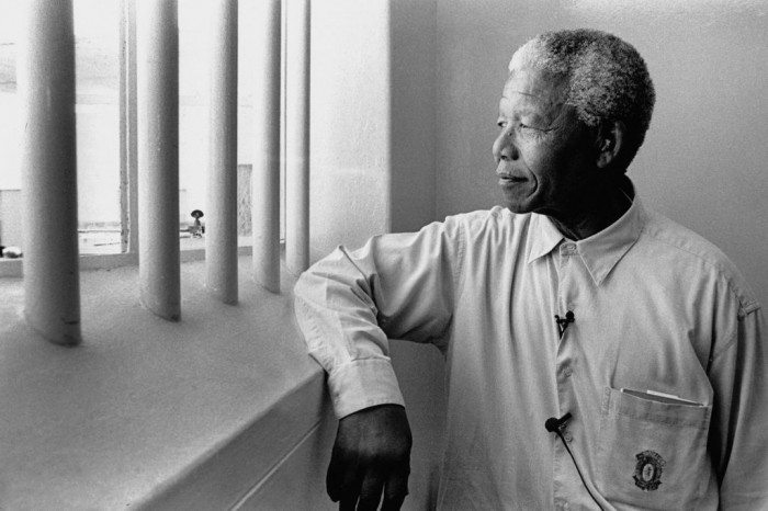 """Nelson-Mandela-revisits-his-prison-cell-on-Robben-Island-2013866 The Anti-apartheid Icon """" Nelson Mandela """" Who Restored His People's Pride"""