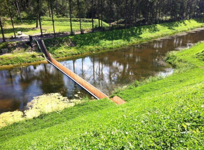 The-Moses-Bridge-is-a-sunken-pedestrian-bridge-in-the-Netherlands-that-parts-moat-waters-like-Moses Have You Ever Seen Breathtaking & Weird Bridges Like These Before?