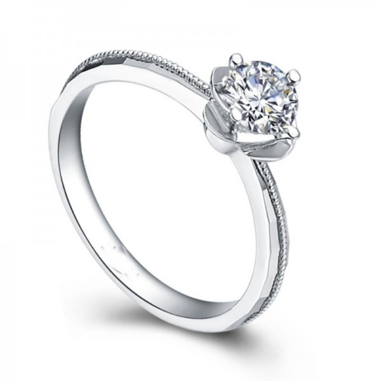 glittering-round-solitaire-diamond-engagement-ring-in-18ct-white-gold 35 Fascinating & Stunning Round Solitaire Engagement Rings