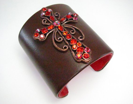 ruby-red-crystal-cross-brown-leather-cuff-bracelet-UDU2Ny0xMDAwNDMuMzE4MDg5 49 Famous Forearm Jewelry Pieces