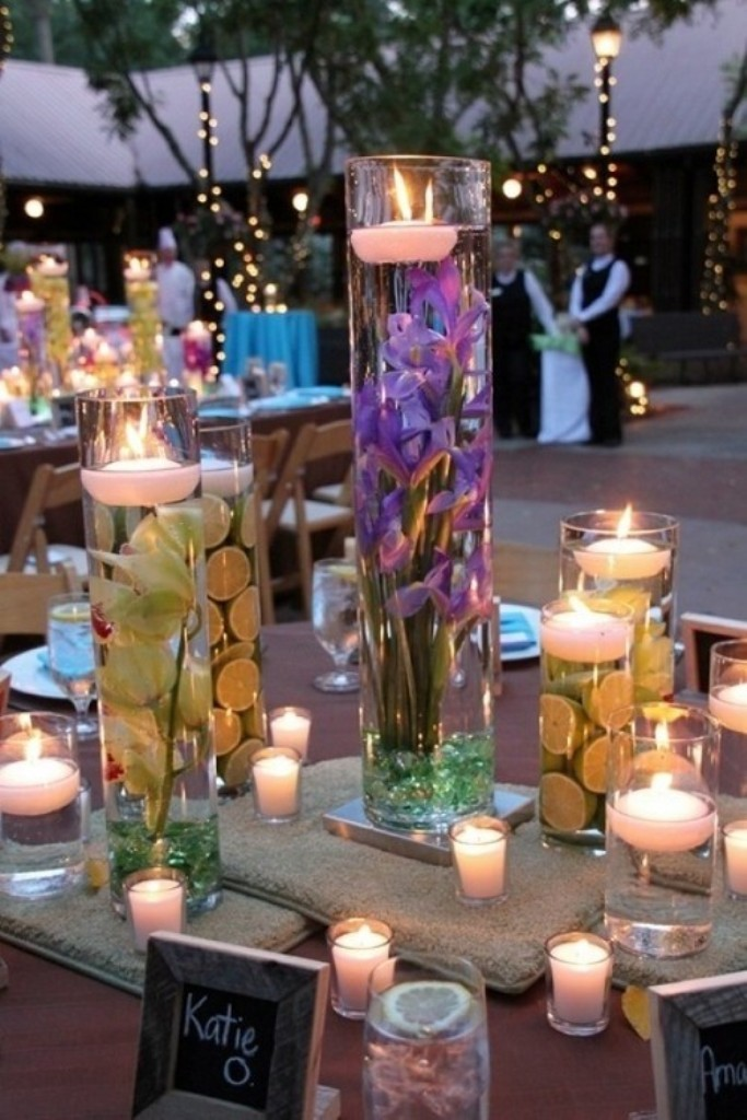 not-this-many-colors-just-the-idea-of-floating-candles.-2014-beach-wedding-table-candle-decorations-f77485 25+ Breathtaking Wedding Centerpieces Trending For 2019