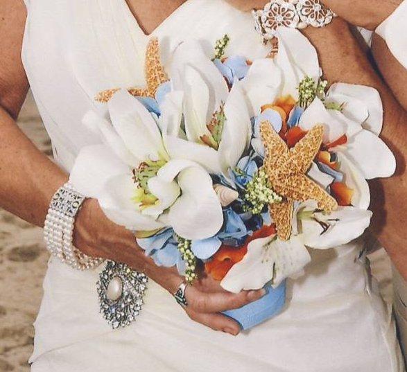 bride-holding-bouquet 7 Tips On Choosing Beach Wedding Accessories