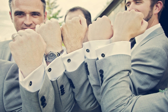 groom-with-groomsmen-show-off-cufflinks Cufflinks: The Most Favorite Men Jewelry