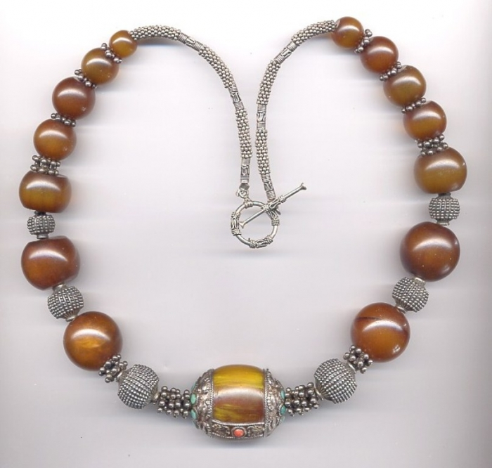 copal-amber-bead Create Unique & Fashionable Jewelry Using Tibetan Silver Beads