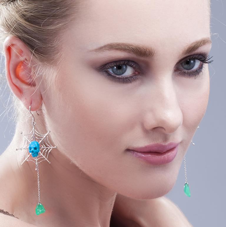 lady-wearing-skull-earrings Skull Jewelry for Both Men & Women