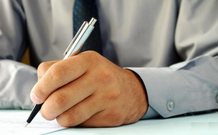 man-writes-on-paper How to Improve Your Handwriting
