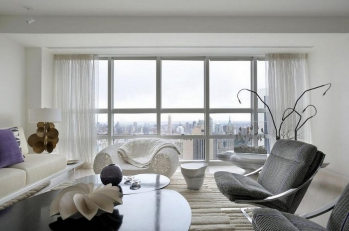 open-living-area-interior-with-grey-upholstered-lounge-chairs-and-white-sheer-curtains-also-black-glass-coffee-table-design-ideas-1024x680 Forecasting--> 25+ Hottest Trends in Home Decoration 2019
