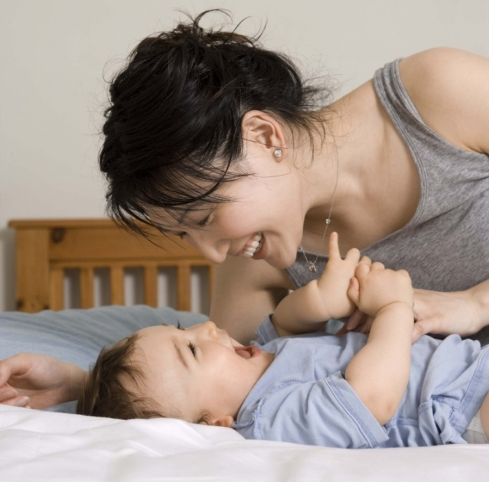 mother-plays-with-baby-happy-1000 How to Be a Happier Mother