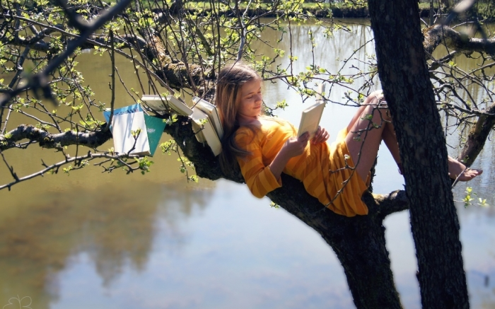 Girl-Read-on-Tree How to Improve Your English Easily & Quickly without Exercises