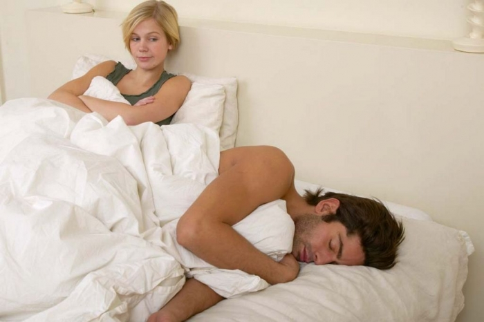 Woman-sitting-up-in-bed How Can I Stop Snoring?
