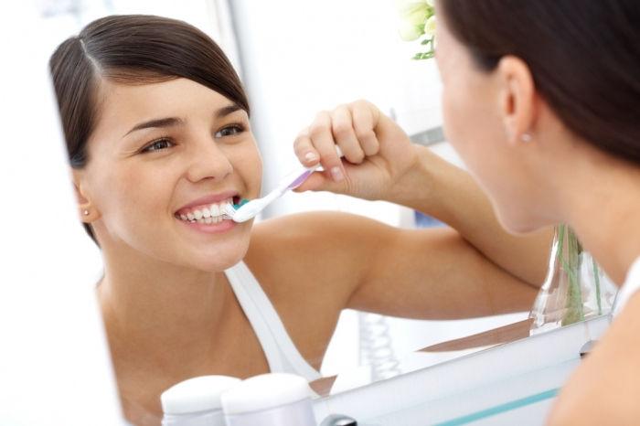 Girl-brushing-teeth How Can I Whiten My Teeth Easily & Naturally?