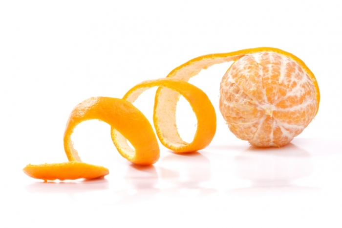 Rub-your-teeth-with-the-inside-of-an-orange-peel How Can I Whiten My Teeth Easily & Naturally?