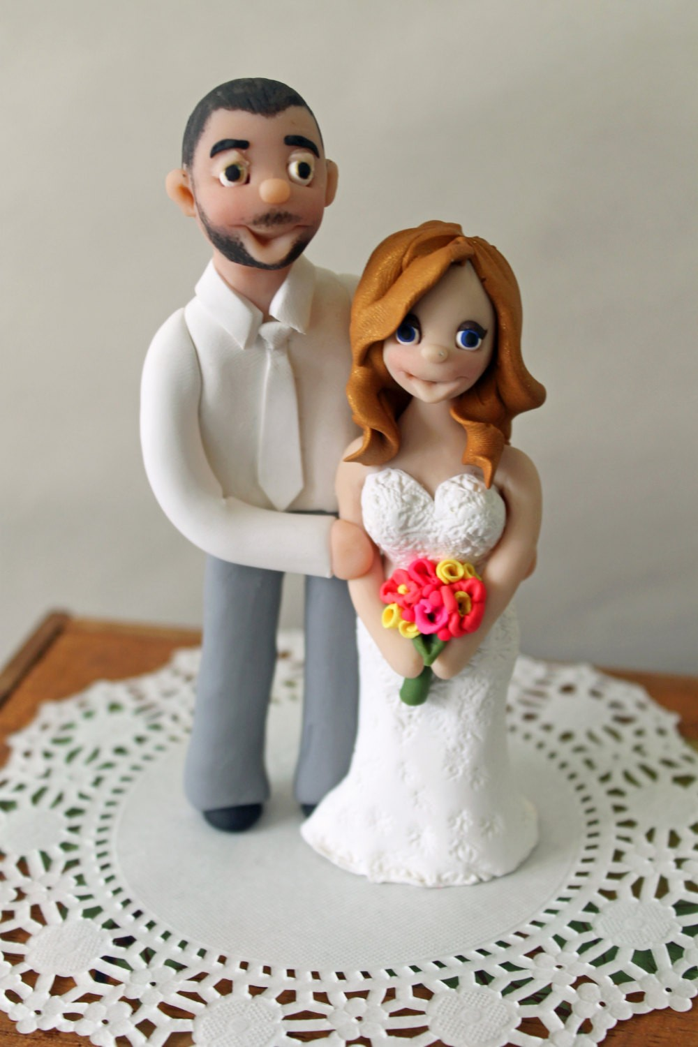 2014-couple-gift-ideas-couple-wedding-cake-toppers-polymer-clay-cake-f43559 Top 10 Most Unique and Funny Wedding Cake Toppers 2017