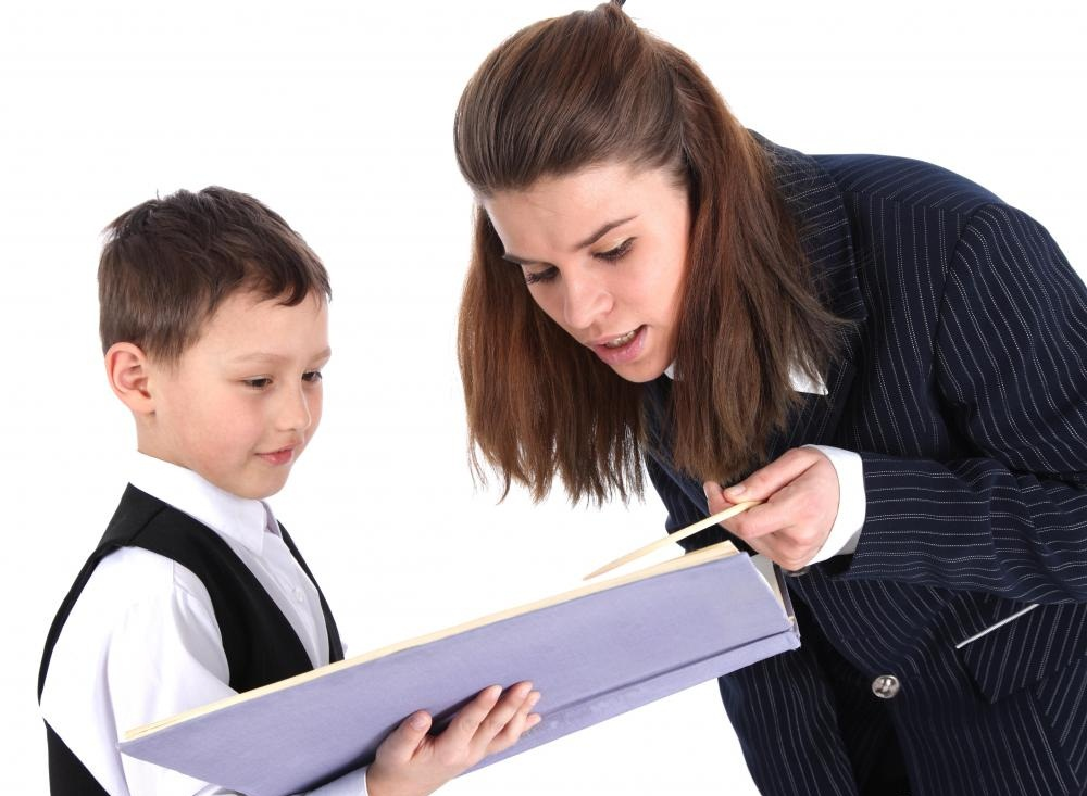 female-teacher-in-suit-with-boy-holding-a-large-book Top 10 Best Jobs for Women in 2018-2019