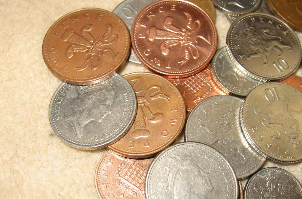 coins-UK-mixed-worn-corroded-used-green-and-red-lighting-copper-1p-penny-pennies-2p-tuppeny-tuppennies-silver-5p-fivepence-10p-tenpence-abstract-closeup-2-JR Top 10 Strangest Pennies Stories in the World