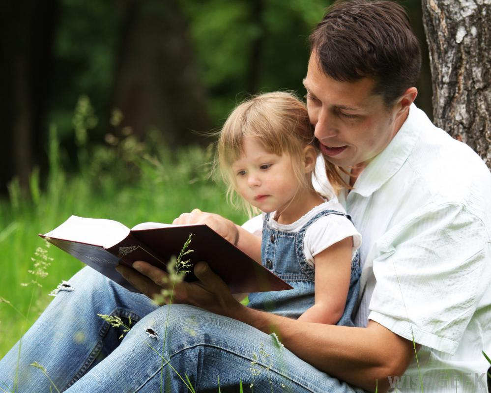 man-and-girl-reading-bible Top 10 Ways to Motivate Your Child to Love Reading