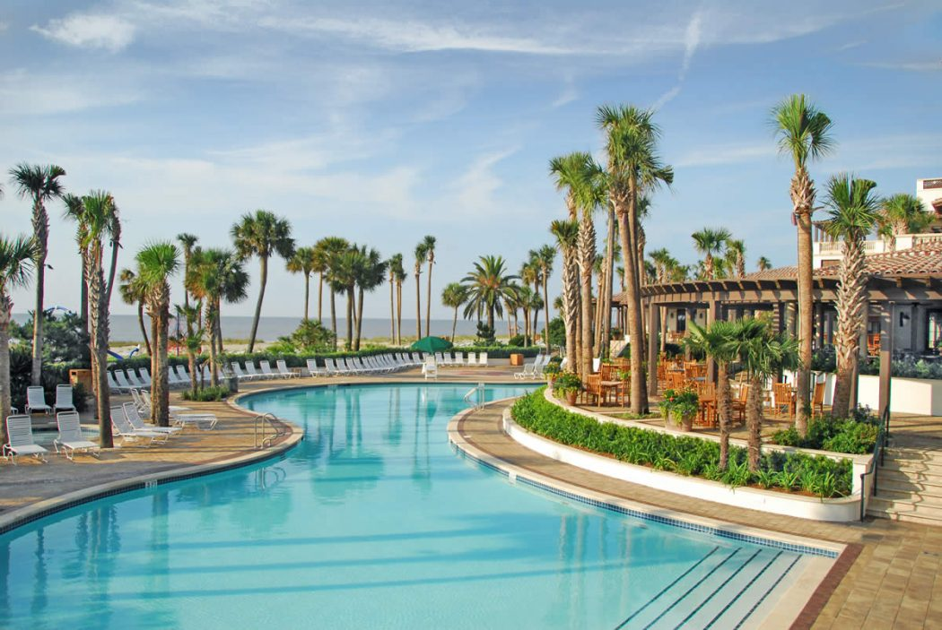 the-lodge-at-sea-island-hotel-pool-image-and-palm Top 10 Best Hotels in USA You Can Stay in