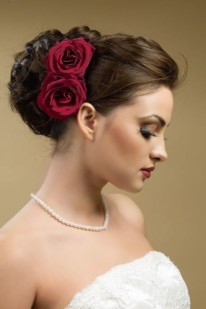 flowers-Wrapped-around-the-bun-3 50+ Most Creative Ideas to Put Flowers in Your Hair ...