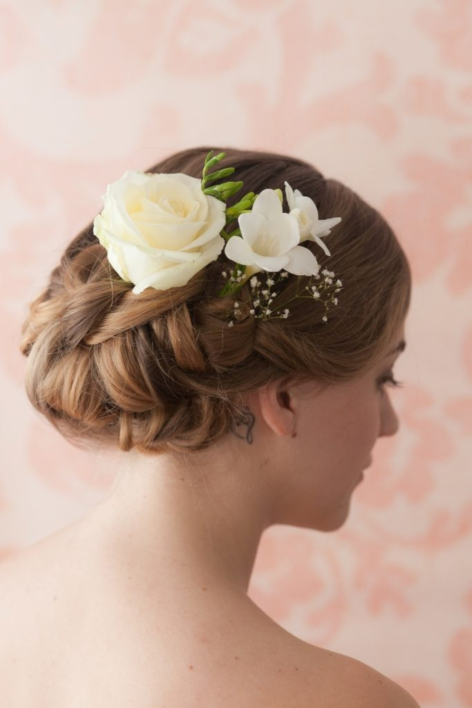 flowers-Wrapped-around-the-bun-5 50+ Most Creative Ideas to Put Flowers in Your Hair ...