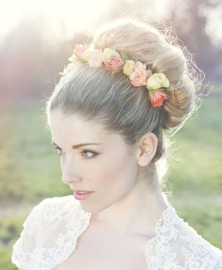 flowers-Wrapped-around-the-bun 50+ Most Creative Ideas to Put Flowers in Your Hair ...