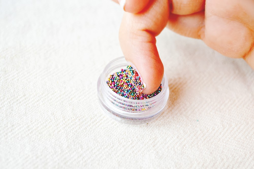 applying-caviar-nail-polish +15 Hottest Caviar Manicure Creative Ideas to Apply in 2020