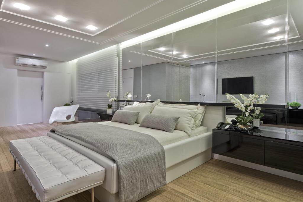 modern-interior-bedroom-design-with-white-headboard-and-beautiful-lighting-in-ceiling-as-well-wooden-floor-and-dark-wooden-vanity-under-the-rectangular-mirror-on-the-wall 5 Main Bedroom Design Ideas For 2020