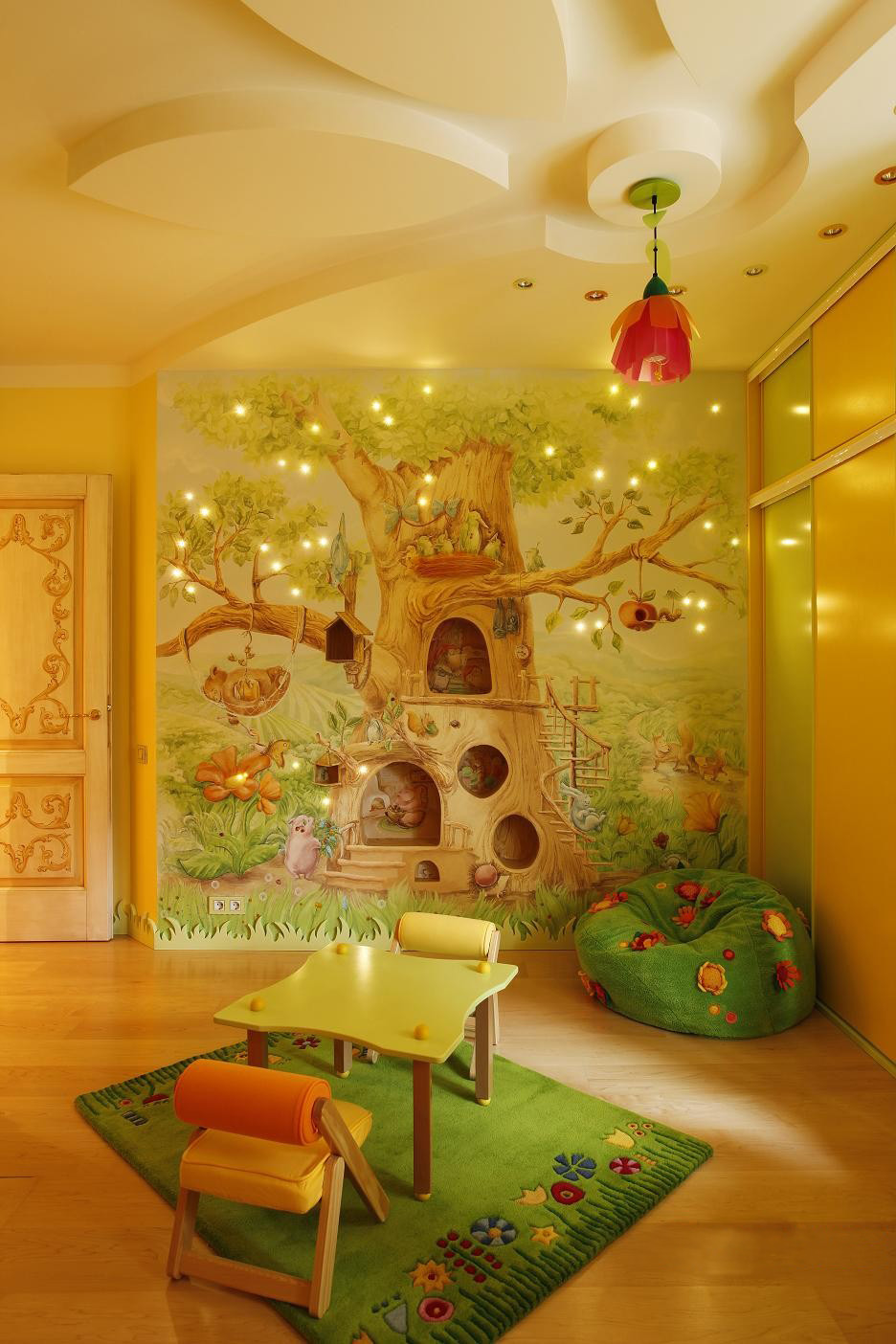 stunning-tree-wallpapers-for-childrens-room-decoration-with-floral-lighting-in-ceiling-as-well-small-table-and-chair-on-green-rug-as-well-wooden-laminate-floor +25 Marvelous Kids' Rooms Ceiling Designs Ideas