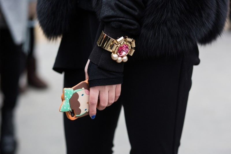 wearing-bracelets-over-gloves-and-sleeves-2 23+ Most Breathtaking Jewelry Trends in 2021 - 2022