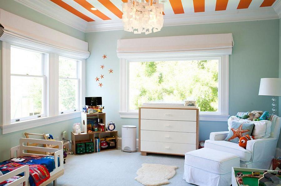 a-fascinating-childs-room-with-cool-blue-wall-and-armchair-also-tasty-orange-stripe-ceiling-with-colorful-bedding-and-toys-shelf-also-charming-chandelier +25 Marvelous Kids' Rooms Ceiling Designs Ideas