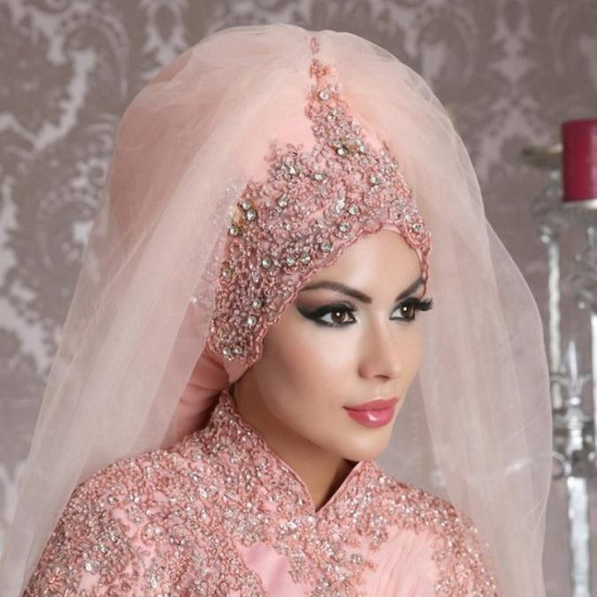 Muslim-bride-in-pink-wedding-dress-675x675 5 Main Muslim Wedding Dresses Trends for 2018