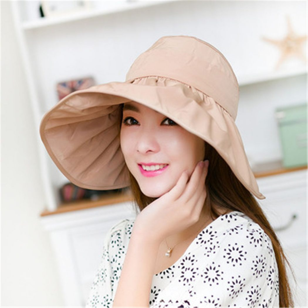 Wide-brimmed-Fabric-Sun-Hat3 10 Women's Hat Trends For Summer 2018