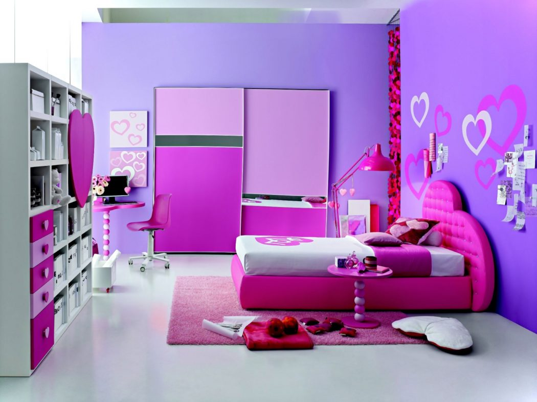 a-luggage-rack-on-the-left-and-a-computer-desk-top-computer-is-also-adjacent-to-the-left-corner-and-then-the-mattress-is-also-the-floor-with-a-pink-carpet-and-wall-with-pink-paint-also 5 Main Bedroom Design Ideas For 2020
