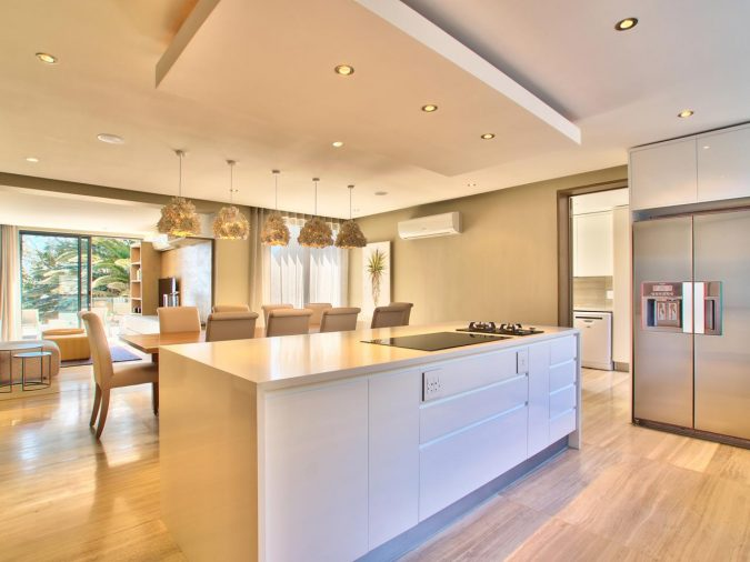 astonishing-kitchen-with-modern-drop-ceiling-combined-rectangle-ceiling-decor-also-small-rounded-lamp-and-white-kitchen-island-featuring-laminate-timber-flooring-ideas-modern-drop-ceili-675x506 6 Suspended Ceiling Decors Design Ideas For 2020