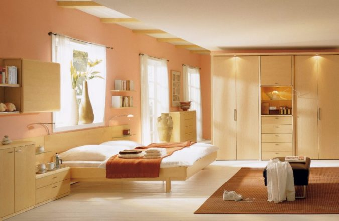 orange-bedroom-with-large-windows-675x440 25+ Elegant Orange Bedroom Decor Ideas